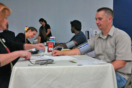 Access employee Brad Bona has his blood pressure checked at the Access Health Fair on August 21, 2013